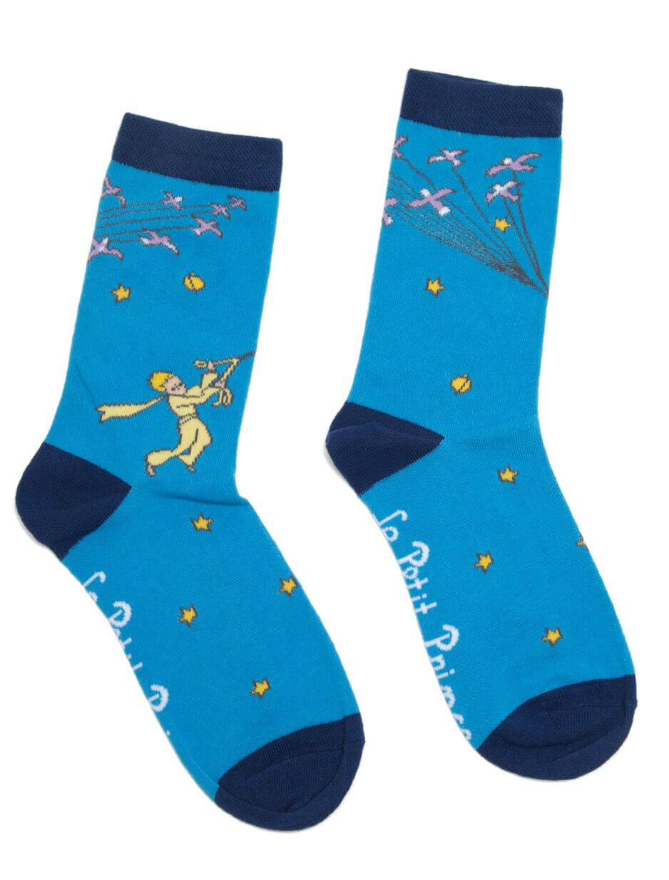 """""""Make your life a dream, and a dream, a reality."""" Cotton blend Unisex Small Size - Sock: 9-11 Large Size - Sock: 10-13 The Little Prince ® © A. de Saint-Exupéry Estate 2016. Purchase of this pair of Le Petit Prince socks sends one book to a community in need"""